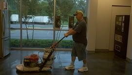 man cleaning floor